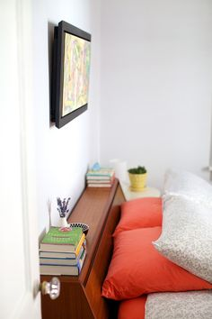 Perfect headboard: slanted for sitting up and clutter-unfriendly: just enough room of a ledge for glasses and water and tiny books.