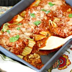 Mama's Meaty Manicotti is a home-style baked Italian favorite with homemade garlic-onion marinara sauce and stuffed with fresh herbs and 3 gooey cheeses.