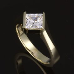 Contemporary bypass semi tension princess diamond solitaire. You like to zig when they zag. Why not wear a princess diamond ring designed that way?