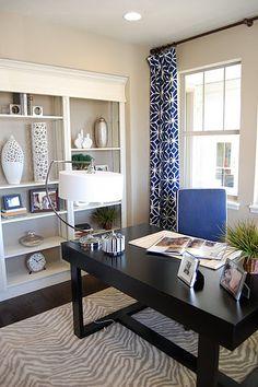 tan apartment walls, espresso furniture, white, and colbalt/navy