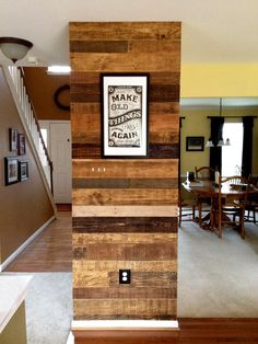 Old Pallets Ideas Pallet wall. Accent wall faced with old pallet wood. Each board individually finished with various stains and waxes. Like the sign says: Make Old Things New Again. Old Pallets, Recycled Pallets, Wooden Pallets, Pallet Wood, Diy Pallet, Wooden Accent Wall, Pallet Accent Wall, Accent Walls, Wall Accents