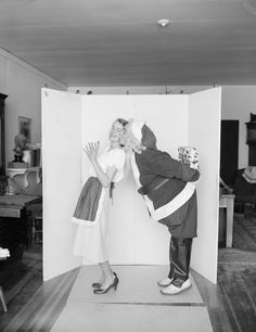 Norman Rockwell's Christmas paintings and the photos behind them.