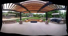 Water feature, cedar bench around gas fire pit, pergola with gas heaters and built in outdoor kitchen!
