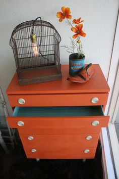 "Annie Sloan chalk paint in ""Barcelona Orange"" and ""Provence"" (on inside of drawers)."