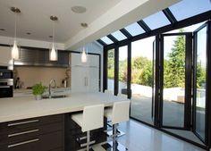 Baie vitrée coulissante-empilable / en aluminium / à double vitrage KITCHEN EXTENSIONS Apropos Tectonic Limited