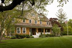 """The homeowner loves the """"salty, old-shore charm"""" of her Rumson, New Jersey, home. - Traditional Home ® / Photo: John Bessler / Architect: Dan Rew"""