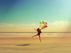 such a feel good image! balloons just have that magic!