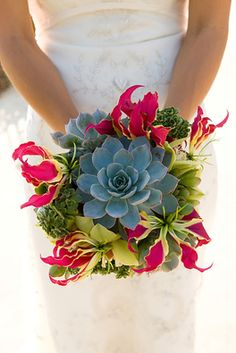 What an AWESOME bouquet! A unique version of the succulent bouquets we see a lot of.