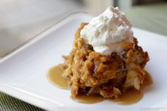 Pumpkin, Apple and Cinnamon Bread Pudding with Caramel Sauce and Whipped Cream