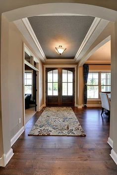 Foyer Entry open to Study/Dining Room - Pocket doors to study? Like the Crown molding in foyer.: