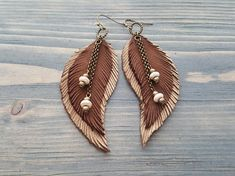 Brown Earrings. Long Feather Earrings. Bohemian Earrings. Bohemian Jewelry. Long Leather Feather Earrings. Boho Tribal Earrings. Hippie Earrings. Materials: genuine leather,bronze jewelry findings,howlite beads. Colour: brown,beige,bronze. Full length with hooks: 9.5 cm( 3.75) If you Diy Leather Earrings, Brown Earrings, Tribal Earrings, Feather Earrings, Leather Jewelry, Metal Jewelry, Jewelry Findings, Etsy Earrings, Beaded Jewelry