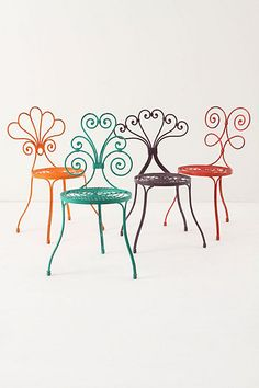 LOVE these chairs. Too bad they are so expensive! Maybe I can get sort of the same look by spray painting my chairs these colors?