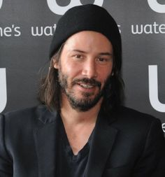 Keanu Reeves (9w8) - Enneagram Type 9 Wing Eight