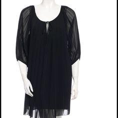 """Diane Von Furstenberg dress. Black Diane von Furstenberg pleated dress with puffed sleeves and tie-string at neckline. Condition: Excellent. Measurements: Bust 38"""", Waist 41"""", Hip 46"""", Length 34"""" Fabric Content: 100% Polyester Diane von Furstenberg Dresses"""