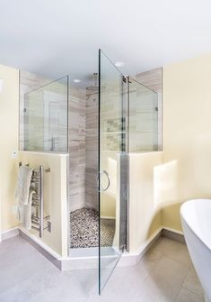 Minimal to the Max with a Luxury Corner Bath. A large corner is cleanly protected by frame-less glass panels and door. A rain shower head ready to pour down onto a natural river rock floor. Bathroom Modern, Master Bathroom, Bathroom Renovations, Home Remodeling, Bathrooms, Custom Shower Doors, All White Room, Corner Bath, Shower Floor