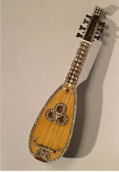 Mandolin        Place of origin:        Perugia, Italy (made)      Date:        1690 (made)      Artist/Maker:        Gavelli, Pietro Antonio (made)      Materials and Techniques:        Ebony, ivory and pine planing, engraved ivory scrollwork, tortoiseshell and ivory marquetry