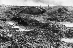 Derelict tanks lie strewn about a chaotic battlefield at Clapham Junction, Ypres, Belgium, ca. 1918. (James Francis Hurley/State Library of New South Wales)