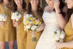 Beauties lined up in yellow and burlap-wrapped bouquets Photography By / http://weheartphotography.com,Floral Design By / http://flowersbysusansimi.com