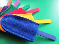 Learning Colors - popsicle sticks with matching felt pockets. Great idea for dramatic play ice cream shop.