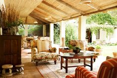 Verandah.  What a spot to curl up with a book until the heat dies down....