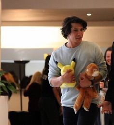 Bellamy with a pikachu and a monkey omg