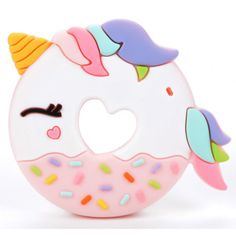 The Loulou Lollipop Teether will appease any fussy baby with its adorable design. Made from silicone that is gentle yet effective on sore teething gums, this teether comes with an attached clip of colorful balls for further stimulation. Unicorn Party, Unicorn Donut, Little Unicorn, Unicorn Kids, Rainbow Unicorn, Baby Teethers, Shops, Project Nursery, Party