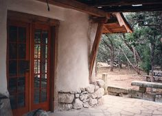 Simple but elegant - rich French doors and fieldstone structure base