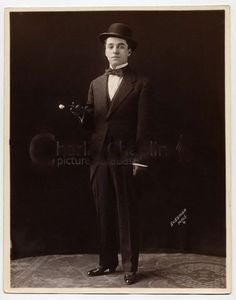 A young and dapper Charlie Chaplin photographed at the Sussman Photo Studio in Minneapolis during his first vaudeville tour of America with the Fred Karno Company, c. 1911.