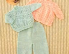 Beautiful knitting pattern for babys layette comprising dress, shawl, cardigan/sweater, bonnet, booties and mittens.  Sizes 12 inch to 20 inch chest (Prem sizes included) Uses DK (sport weight) yarn  NO RESALE RIGHTS - pattern only for personal use - in accordance with Etsys policies