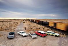 A collection of vintage cars parked on the outskirts of Marfa, Texas, photographed by John Huba.