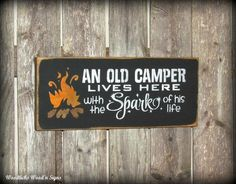 """""""An Old Camper Lives Here With The Spark Of His Life"""". Wooden Signs for the Campsite"""