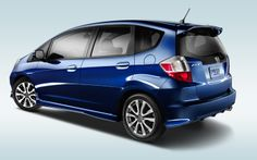 Complementing its aggressive design, an underbody kit, rear roofline spoiler and chrome exhaust finisher come standard on the Fit Sport | www.crownhonda.ca