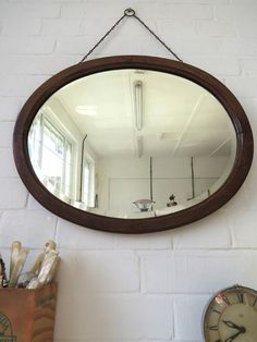 Lovely Art Deco mirror with bevelled edge and wooden frame . Great period item for any contemporary setting.  PS! If you are on the look out for a unique mirror, do not hesitate to take look at our collection of vintage mirrors!  Item Specifics NR70  Height: 43cm (approx 17.00) Width: 53.5cm (approx 21.00) Weight: 3.60kg ref:4972  Condition :light age related ware on the frame