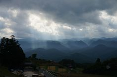 sun beams from the space of clouds to the National park mountains in front of Sasayuri-ann villa.