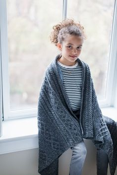 Cast on a beautiful cabled heirloom. Bairn is given in two versions: a large nap blanket knit in Shelter that will serve a child as he grows or make a handsome throw in the living room, and a smaller baby blanket worked in Loft to tuck into a pram or use as a stylish nursing …
