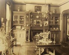 This beautifully appointed victorian dining room features a fireplace and a well stocked hutch. (1890s)