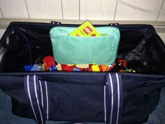 Large Utility Tote to hold legos and a pocket a tote to hold all those instruction booklets that are always lost - Ashley B
