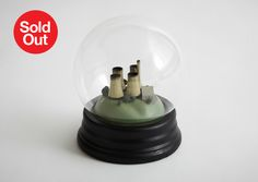 No Globes Mixed media snow globe H20 x W20 x D20cm  The single greatest threat to the climate comes from burning coal but despite this a...