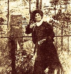 "Calamity Jane at the gravesite of ""Wild Bill"" Hickock. Mount Moriah Cemetary. Deadwood, SD."