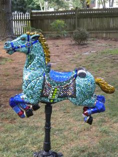 hummmmm  not only mosaic on but could glue/screw driftwood over whole thing or cover w/ fine mesh wire or screen and use as topiary (drilling holes to place roots of plant and soil in, plus to water)        salvaged plastic horse