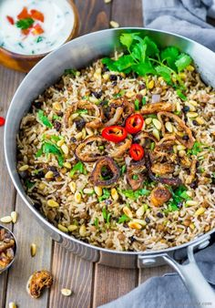 Mujaddara - Spiced lentils and rice prepared with long grain Basmati Rice, Brown Lentils, and warm spices which make this vegetarian meal rich, protein-packed, and delicious. With crunch of toasted...
