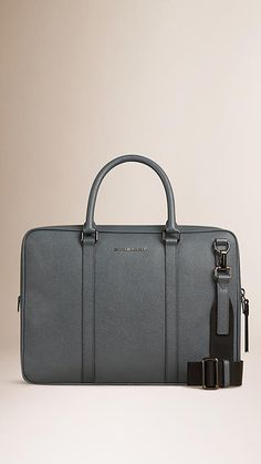 Burberry Stone Grey London Leather Crossbody Briefcase - London leather briefcase with rolled leather handles and detachable webbed canvas crossbody strap. Ziparound closure with oversize zip pulls, polished metal hardware. Discover men's tailoring at Burberry.com