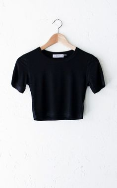- Description - Size Guide Details: Super cute ribbed short sleeve round neck crop top in black. Form-fitting, tend to run on the smaller side & are more fitted. 95% Rayon, 5% Spandex. Imported. Sizin