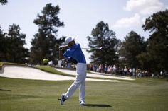 Asia-Pacific Amateur Championship winner, 14 year old Guan Tianlang of China hits his tee shot on the third hole during a practice round in preparation for the 2013 Masters golf tournament at the Augusta National Golf Club in Augusta, Georgia, April 9, 2013. REUTERS/Mike Segar