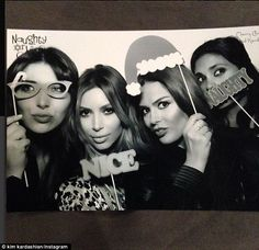 Naughty or nice? Kim poses up with all her friends in the photo booth...