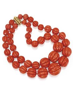 Coral Bead Necklace, Verdura ~ The double-strand necklace composed of 44 fluted coral beads graduating in size from approximately 25.0 to 10.0 mm, completed by an 18 karat gold beadwork clasp, length approximately 13¾ inches,