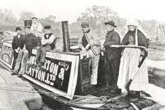 """The Fellows Morton and Clayton steamer """"Baron"""" moored with a boatwoman and two men on the stern and 4 boys and men on the cabin. Birmingham Canal, Narrowboat Interiors, Steam Boats, Canal Boat, Old Photographs, Old Pictures, Long Distance, 19th Century, Narrow Boat"""