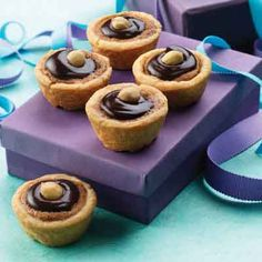 A change from traditional pecan tassies or mini tarts, this recipe uses a candy bar as part of the filling.