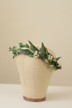 Custom Greenery Flower Crown with eucalyptus leaves, olive leaves, wispy greenery and small white flowers for the bohemian bride. Leaf Crown by Love Sparkle Pretty http://lovesparklepretty.com/shop/