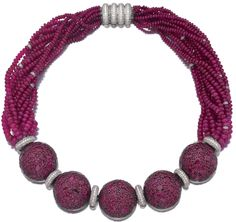 Ruby and diamond necklace, Michele della Valle. The front decorated with five half spheres set with circular-cut and oval rubies spaced by brilliant-cut diamond roundels, continuing to a torsade of ruby beads accented with brilliant-cut stones and a barrel-shaped diamond set clasp, length approximately 435mm, maker's marks and numbered, pochette. Sotheby's.